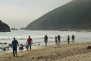 Families and people walking on sand and enjoying the day at Pfeiffer Beach, Big Sur Coast, Monterey County, California