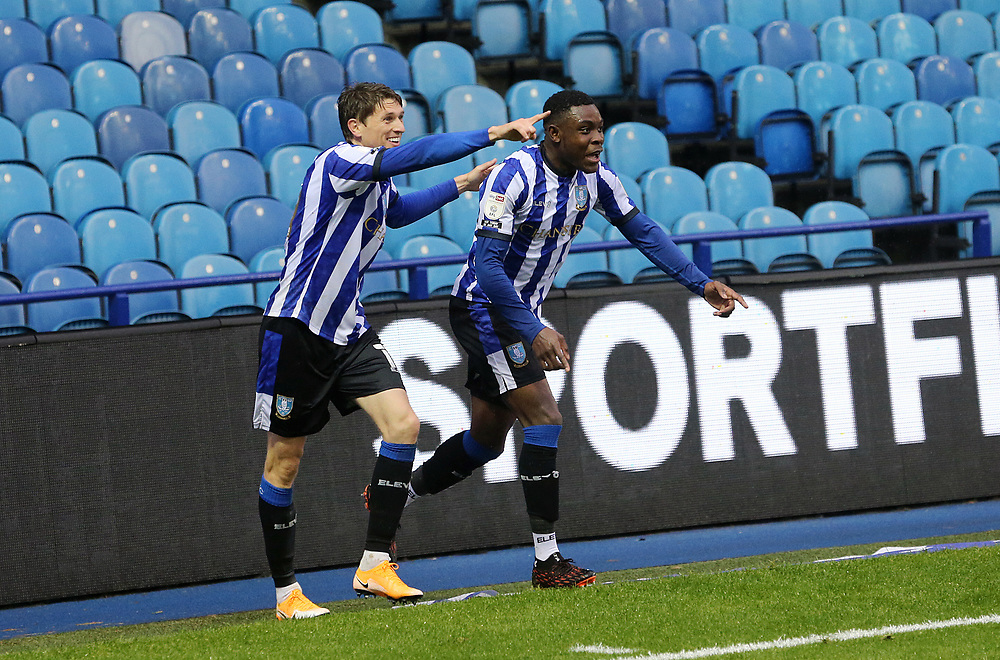Sheffield Wednesday's Adam Reach (left) celebrates with team-mate Kadeem Harris after his ball into the box led to an own goal being conceded by Queens Park Rangers' Yoann Barbet<br /> <br /> Photographer Rich Linley/CameraSport<br /> <br /> The EFL Sky Bet Championship - Sheffield Wednesday v Queens Park Rangers - Saturday 3rd October 2020 - Hillsborough Stadium - Sheffield <br /> <br /> World Copyright © 2020 CameraSport. All rights reserved. 43 Linden Ave. Countesthorpe. Leicester. England. LE8 5PG - Tel: +44 (0) 116 277 4147 - admin@camerasport.com - www.camerasport.com
