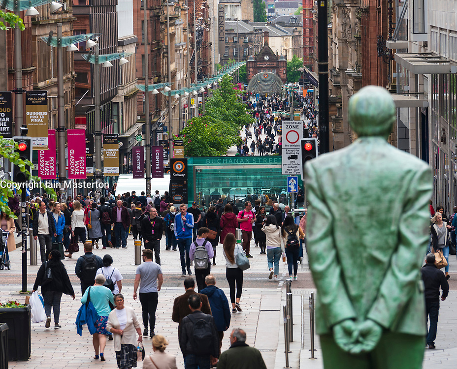 View of shoppers and statue of Donald Dewar on Buchanan Street the main pedestrian shopping street in Glasgow, Scotland, UK