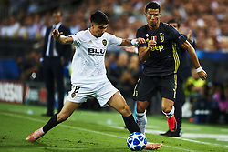 September 19, 2018 - Valencia, Spain - Carlos Soler, Cristiano Ronaldo (R) competes for the ball during the Group H match of the UEFA Champions League between Valencia CF and Juventus at Mestalla Stadium on September 19, 2018 in Valencia, Spain. (Credit Image: © Jose Breton/NurPhoto/ZUMA Press)