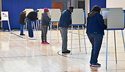 Voters cast their ballots inside the gymnasium at Abraham Lincoln School in Belleville on Tuesday, November 3, 2020.  <br /> Photo by Tim Vizer