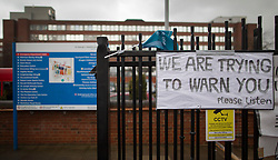 © Licensed to London News Pictures. 09/03/2016. London, UK. A warning sign is mounted on the fence as doctors picket St George's hospital in Tooting. Junior doctors are continuing their strike action after the government said it intended to impose a new employment contract. Photo credit: Peter Macdiarmid/LNP