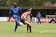 Adebayo Akinfenwa scores during the Pre-Season Friendly match between AFC Wimbledon and Cheltenham Town at the Cherry Red Records Stadium, Kingston, England on 1 August 2015. Photo by Stuart Butcher.