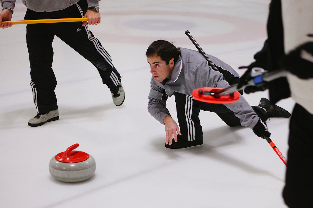 Ryan Winterbourne of San Jose delivers during the San Francisco Bay Area Curling Club's Tuesday night league at Sharks Ice in San Jose on Jan.15, 2013.
