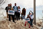 02022020 - Iowa City, Iowa, USA: Supporters stand on a snow bank as Democratic Presidential Candidate Bernie Sanders speaks at the Ceder Rapids field office, Sunday, February 2, 2020 in Cedar Rapids, Iowa. (Jeremy Hogan/Polaris)
