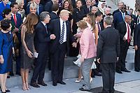 07 JUL 2017, HAMBURG/GERMANY:<br /> Kim Jeong-suk, Ehefrau von Moon Jae-in, Juliana Awada, Ehefrau von Mauricio Macri, Mauriocio Macri, Praesident von Argentinien, Donald Tump, Praesident Vereinigte Staaten von Amerika, USA, Angela Merkel, CDU, Bundeskanzlerin, Melania Trump, Ehefrau von Donald Trump, Joachim Sauer, Ehemann von Angela Merkel, (v.L.n.R.), Merkel weist Trump seine Platz in der zweiten Reihe zu, Familienfoto der G20 Teilnehmer und ihrer Partner vor der Elbphilharmonie<br /> IMAGE: 20170707-02-010<br /> KEYWORDS: G20 Summit, Deutschland, Elphi