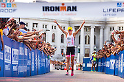 Top female finisher Britta Martin of New Zealand makes her way to the finish line during the Ironman Wisconsin triathlon. (Photo © Andy Manis)