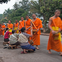 The next morning i missed the wake up call to see the monks receiving alms. While i took the camera and run out of the guesthouse, the monks were already walking along the street.