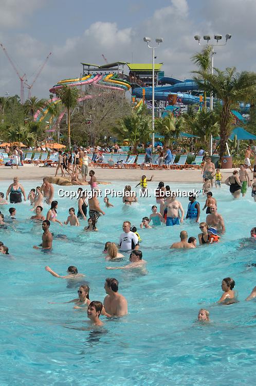 Park guests swim in the Cutback Cove wave pool at Sea World's new waterpark Aquatica in Orlando, Florida.