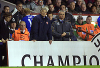 Arsene Wenger (Arsenal Manager) shows his concern as Claudio Ranieri (Chelsea Manager) looks on. Arsenal v Chelsea. UEFA Champions League 1/4 Final 2nd leg @ Highbury. Credit : Andrew Cowie, Digitalsport