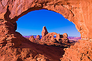 Morning light on Turret Arch through North Window, Arches National Park, Utah