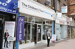 © London News Pictures. 14/07/2013. COPY AVAILABLE BELOW…. The Childrens Trust charity shop on Orpington High Street, Kent. Orpington High street now has 12 charity shops  in one short stretch, with Cancer Research UK having two shops on different sides of the high street almost facing each other.  COPY AVAILABLE HERE:  http://tinyurl.com/nhtxtyd<br /> <br /> Photo credit :Grant Falvey/LNP