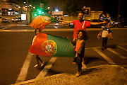 Portuguese football fans in Lisbon celebrate their country's victory over France in the Euro 2016 tournament final.
