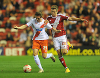 Blackpool's John Lundstram and Middlesbrough's Patrick Bamford battle for the ball<br /> <br /> Photographer Dave Howarth/CameraSport<br /> <br /> Football - The Football League Sky Bet Championship - Middlesbrough v Blackpool - Tuesday 30th September 2014 - Riverside stadium - Middlesbrough<br /> <br /> © CameraSport - 43 Linden Ave. Countesthorpe. Leicester. England. LE8 5PG - Tel: +44 (0) 116 277 4147 - admin@camerasport.com - www.camerasport.com
