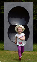 © Licensed to London News Pictures. 24/05/2012. Waddesdon, UK. Christina Tullie, aged 3 and a half, runs near a Anish Kapoor sculpture. People enjoy the warm weather amongst an exhibition of contemporary sculpture at Waddesdon Manor, Buckinghamshire, today 24th May 2012. The exhibition is being held by Christie's as part of a private sale. Photo credit : Stephen Simpson/LNP