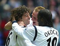 Photo Aidan Ellis.<br />Bolton Wanderers v Manchester City (FA Barclaycard Premiership) 05/04/2003.<br />Bolton scorer Ivan Campo celebrates with team mates Jay Jay Okocha and Henrik Pedersen