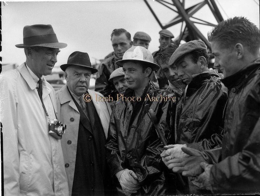 03/08/1962<br /> 08/03/1962<br /> 03 August 1962<br /> Oil representatives at Rathmolyon, Co. Meath. Mr F. Kirk Johnston, Chairman, Ambassador Oil Corporation, and President Ambassador Irish Oil Co. and Mr James Stewart, Film Star and Ambassador Shareholder pictured chatting with some of the workers on the site of the 1st Oil Drilling at Rathmoylon.