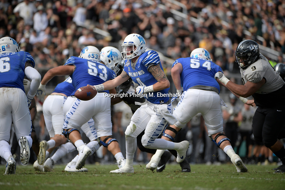 Memphis quarterback Riley Ferguson (4) fakes a handoff during the first half of the American Athletic Conference championship NCAA college football game against Central Florida Saturday, Dec. 2, 2017, in Orlando, Fla. (Photo by Phelan M. Ebenhack)