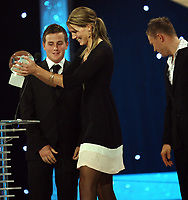 Idrettsgalla  for 2006 , 6  januar 2007 ,<br /> Hamar OL-Amfi<br /> <br /> Foto:Dagfinn Limoseth - Digitalsport <br /> <br /> Marius Thorp og Thor Hushovd delt ut prise Årets lagspiller som gikk til Gro Hammerseng
