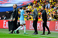 Substitution - Riyad Mahrez (26) of Manchester City shakes hands with Manchester City manager Pep Guardiola after being replaced by Kevin De Bruyne (17) of Manchester City during the The FA Cup Final match between Manchester City and Watford at Wembley Stadium, London, England on 18 May 2019.