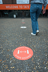 © Licensed to London News Pictures. 24/07/2020. LONDON, UK. Signage outside the entrance way to the Turbine Gallery. Press preview ahead of the reopening of Tate Modern on 27 July after the easing of coronavirus pandemic lockdown restrictions by the UK government.  Visitors will need to book timed tickets online and follow one-way routes around the gallery space along with observing social distancing rules.  Photo credit: Stephen Chung/LNP