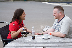 Young couple sitting in the park café having a drink,
