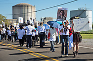 Opponents of Entergy's Natural Gas Power plant in New Orleans East march along River Road in Cancer Alley on March 3, 2018.  The march passed Entergy's Waterford 3 Nuclear Generating Station and  Dows Chemical Plant, ending at the Taft Cemetery. 4