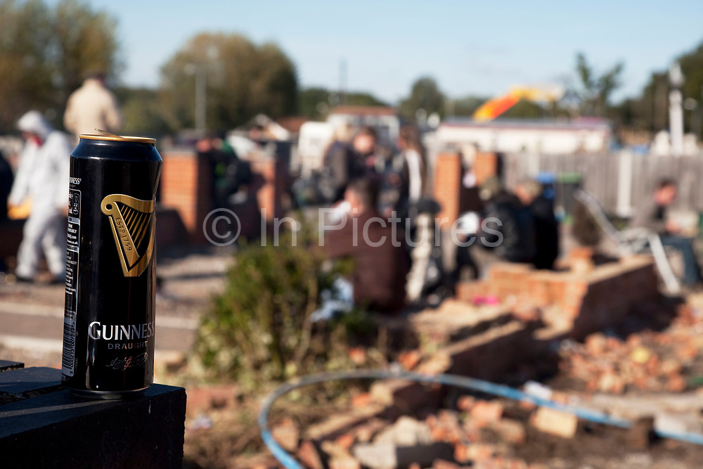Guinness can. Travellers at Dale Farm site prior to eviction. Riot police and bailiffs were present on 20th October 2011, as the site was cleared of the last protesters chained to barricades. Dale Farm is part of a Romany Gypsy and Irish Traveller site in Crays Hill, Essex, UK<br /> <br /> Dale Farm housed over 1,000 people, the largest Traveller concentration in the UK. The whole of the site is owned by residents and is located within the Green Belt. It is in two parts: in one, residents constructed buildings with planning permission to do so; in the other, residents were refused planning permission due to the green belt policy, and built on the site anyway.