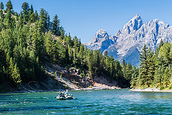 Fly-fishing the Snake River in Grand Teton National Park.   The towering peaks make it difficult to watch your fly.
