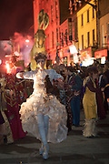 25/10/2015 Vicky McCormack performing in the Macnas parade on the streets of Galway. 'The Shadow Lighter' featured the new Macnas character of Danu – a 15 ft high wild woman, the shadow lighter mistress of old stories, magic and medicine. Alongside her walked Danu's spirit animal, The Wolf of Danu, a beautiful, strong and fierce wolf, circling around Danu to protect her.  <br /> <br /> DUBLIN MONDAY NIGHT.<br /> Macnas will close the Bram Stoker Festival at twilight on Monday 26th October. In what is set to be another breath-taking citywide procession, Dublin's city streets will transform as the journey of Danu takes place, beginning in 3 city centre locations at 5.30pm with a final gathering in Wolfe Tone Square. This is a deadly adventure given life on the streets of Dublin.  Procession routes will be available to see and download from bramstokerfestival.com .Photo:Andrew Downes, xposure