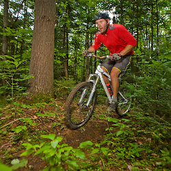 A man rides his mountain bike at Moose Brook State Park in Gorham, new Hampshire.