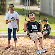 Students and parents enjoy a play day at the Arabic Immersion Magnet School, July 18, 2015.
