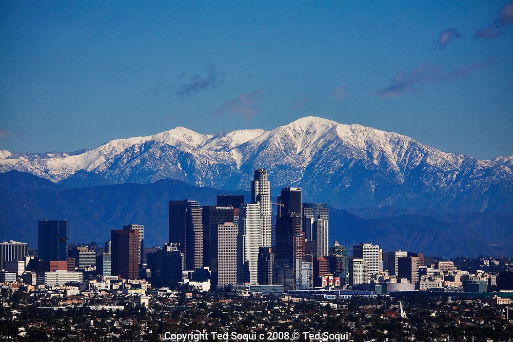 View of Downtown Los Angeles with a snow capped Mt. Baldy of the San Gabriel Mountain Range in the background.. Los Angeles skyline.