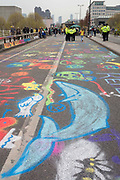 Environmental graffiti made by Climate Change activists with Extinction Rebellion campaigning for a better future for planet Earth after blocking Waterloo Bridge and as part of a multi-location 5-day Easter protest around the capital, on 16th April 2019, in London, England.