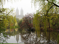 The Lake in central Park with the San Remo apartment building in the distance.