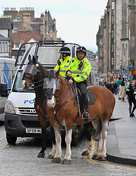 Pictured: A heavy police presence included riot vans at mounted officers.<br /> <br /> Climate change protesters blocked roads in the city centre including North Bridge, causing severe traffic disruption.<br /> <br /> © Dave Johnston / EEm