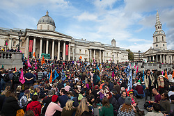 London, UK. 16 October, 2019. Hundreds of climate activists from Extinction Rebellion defy the Metropolitan Police prohibition on Extinction Rebellion Autumn Uprising protests throughout London under Section 14 of the Public Order Act 1986 by attending a Right to Protest assembly in Trafalgar Square. The Metropolitan Police made arrests, including Green Party co-leader Jonathan Bartley and Guardian journalist George Monbiot, after a group of protesters sat down in the road in Whitehall.
