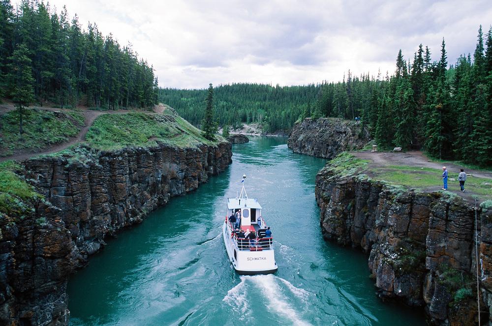Canada. Yukon . Whitehorse. Tour boat sails through Miles Canyon, a turbulent narrow canyon along the Yukon.