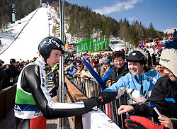 Robert Kranjec (SLO) with fans at Flying Hill Team in 3rd day of 32nd World Cup Competition of FIS World Cup Ski Jumping Final in Planica, Slovenia, on March 21, 2009. (Photo by Vid Ponikvar / Sportida)