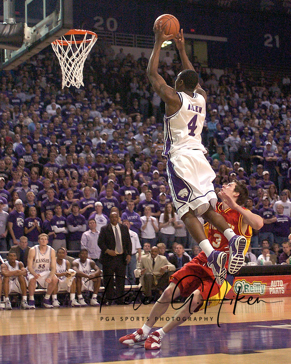 Kansas State's Curtis Allen (4) flies to the basket over Iowa State's John Neal (3) in the second half at Bramlage Coliseum in Manhattan, Kansas, February 8, 2006.  K-State defeated the Cyclones 66-63.