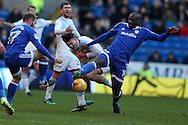 Jack Grealish of Aston Villa is fouled by Sol Bamba of Cardiff city ®. EFL Skybet championship match, Cardiff city v Aston Villa at the Cardiff City Stadium in Cardiff, South Wales on Monday 2nd January 2017.<br /> pic by Andrew Orchard, Andrew Orchard sports photography.