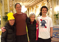 2014 Boston Marathon: Joan Samuelson with family in hotel lobby early morning before going to starting line for the race