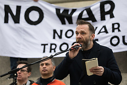 London, UK. 11 January, 2020. Joe Glenton, journalist and an ex-soldier who served in Afghanistan, addresses the No War on Iran demonstration in Trafalgar Square organised by Stop the War Coalition and the Campaign for Nuclear Disarmament to call for deescalation in the Middle East following the assassination by the United States of Iranian General Qassem Soleimani and the subsequent Iranian missile attack on US bases in Iraq.