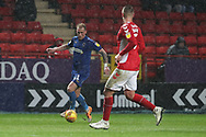AFC Wimbledon midfielder Mitchell (Mitch) Pinnock (11) taking on Charlton Athletic defender Patrick Bauer (5) during the EFL Sky Bet League 1 match between Charlton Athletic and AFC Wimbledon at The Valley, London, England on 15 December 2018.