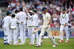 South Africa's Morne Morkel celebrates taking the wicket of England's Alastair Cook (centre) during day three of the Fourth Investec Test at Emirates Old Trafford, Manchester.