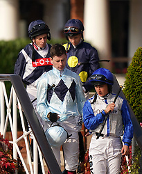 Ryan Moore, David Probert, Oisin Murphy and Nicola Currie make their way to the Dubai Nursery Handicap at Newmarket Racecourse. Picture date: Saturday October 9, 2021.