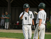 Hank Vincent fist pumps Mike Platt after driving in a run for Sunapee during Division IV semi final baseball with Colebrook at Plymouth State University Wednesday evening.   (Karen Bobotas/for Valley News)