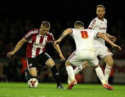 Brentford's Jake Bidwell takes on Middlesbrough's Adam Clayton - Photo mandatory by-line: Robbie Stephenson/JMP - Mobile: 07966 386802 - 08/05/2015 - SPORT - Football - Brentford - Griffin Park - Brentford v Middlesbrough - Sky Bet Championship