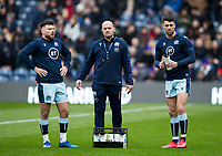 Rugby Union - 2020 Guinness Six Nations Championship - Scotland vs. France<br /> <br /> Scotland Head Coach Gregor Townsend with Ali Price of Scotland and Adam Hastings of Scotland during the warm up, at Murrayfield