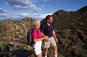 Hikers enjoy the clean air and pristine views of Tucson from the Tucson Mountains, Arizona.©1992 Edward McCain. All rights reserved. McCain Photography, McCain Creative, Inc.